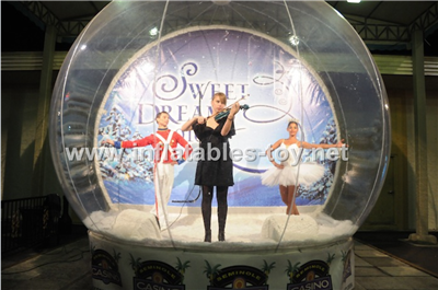 Human snow globe for live show